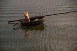 Paddling across River in the Danang Area of Vietnam
