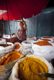 A Woman Weighing Spices on a Market Stall