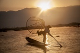 A Fisherman on Inle Lake in the Early Morning