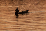 A Fisherman on the Hoi an River at Daybreak