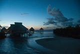 Resort Cottages at Sunset on Bora Bora