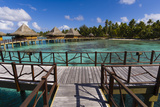 Over-The-Water Bungalows at a Tropical Resort with Turquoise Waters