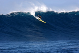 Garrett Mcnamara  Big Wave Surfer  Surfing Down a Wave Face at Jaws