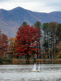 Toy Sailboats in a Lake in a Mountain Valley in Autumn