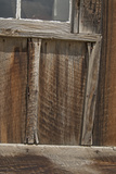 Old Weathered Wood Covers the Wall of a Building