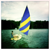A Woman Sails a Small Boat across Sebago Lake