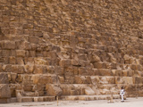 A Man Walks by the Base of the Great Pyramid of Giza