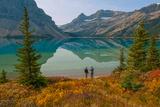 Two Men Stand by a Lake Reflecting Portal Peak