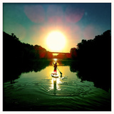 A Boy Paddles His Paddle Board on the Potomac River