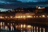 A Bridge and Reflections in the Arno River at Dawn