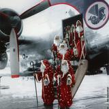 Ten Santa Claus Deplaning December 15  1953 Colorized Document