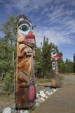 Totem Poles with Beaver Image in the Foreground