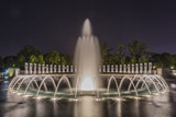 The Fountains and Sculpture of the World War Ii Memorial Lit Up at Night