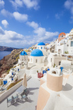 Greek Church with Three Blue Domes in the Village of Oia