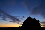 Silhouetted Sandstone Formation at Dawn
