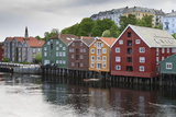 Colourful Wooden Warehouses on Wharf Beside the Nidelva River