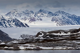 Glacier Backed by Snowy Mountains