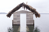 High Water Floods Lakeside Cabanas  Climate Change  Lago Peten Itza  Guatemala  Central America