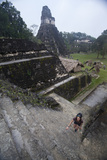 Woman Climbing Stairs at Mayan Archaeological Site  Tikalguatemala  Central America