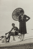 Young Woman with Umbrella and Boy on Pedal Boats on the Beach of Forte Dei Marmi
