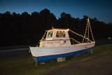 Old Fishing Boat on Land at Dusk