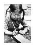 Chinesisches Mädchen beim Schreiben  1940