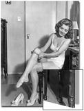 Woman putting on stockings  1933