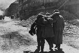 Wounded Soviet (Russian) Soldier Helped by Two Comrades in a Street Filled with Rubble  Vienna