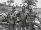 Robert Capa (Left) and Ernest Hemingway (Right) with their Driver US Army Driver