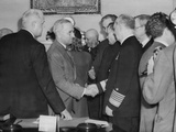 A Solemn Harry Truman Shakes Hands with Admiral William Leahy after Being Sworn in as President