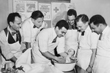 Expectant Fathers Bathing a Doll During an Infant Care Class at the Brooklyn Red Cross Headquarters