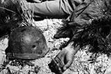 US Soldier's Bullet-Pierced Helmet Lying Next to His Body in a South Korean Battlefield