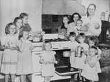 Mr and Mrs Lloyd Brooks of Pittsfield  Maine  and their 12 Daughters