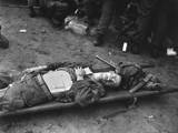 US 21st Infantry Soldier Lies on a Stretcher at a Medical Aid Station