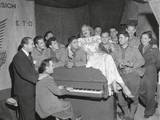 Actress Marlene Dietrich Singing for a Group of GI's in France