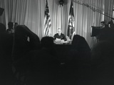President Harry Truman Seated at His Desk with Lights on and Cameras Rolling
