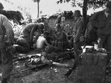 US Soldiers Receive Medical Treatment at a First Aid Station Near South Korean Battle Front