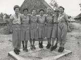 GI 'Little Abners' Shoes are Modeled by Nurses of a Medical Regiment in New Guinea  Port Moresby
