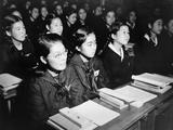 Japanese Girls Seated at Desks in Newly Rebuilt Catholic School in Tokyo  Japan