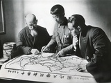Chinese Army Officer and Two Missionaries Plot the Advance of Communist Forces
