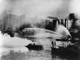 London Firemen Direct Water from their Fireboats onto Blazing Warehouse