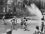 Children Escape the Heat of the East Side by Opening a Fire Hydrant  New York City  June 1943