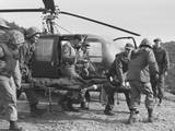 A Seriously Wounded US Marine Is Rushed to Helicopter by the Corpsmen