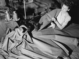 A Young Woman Sews 'Pup' Tents for the US Army