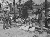 US Marines Guarding Three Captured North Koreans  in an Urban Setting  Ca 1950