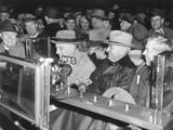 President Franklin Roosevelt Speaking into Radio Microphones from His Open Car in the Rain