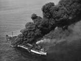 A Torpedoed American Tanker Burning after an Axis Submarine Attack