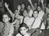 Puerto Rican Children in a Classroom  Some with Hands Raised New York City  April 25  1947