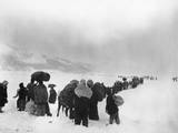 Korean Refugees Slog Through Snow Outside of Kangnung (Gangneung)