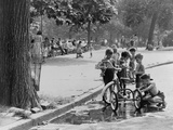 Children with Tricycles Play Near a Puddle in Washington Square Park New York City Aug 3  1948